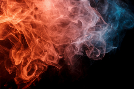 background e cigarette: Abstract smoke Weipa. Personal vaporizers fragrant steam. The concept of alternative non-nicotine smoking. Orange turquise smoke on a black background. E-cigarette. Evaporator. Taking Close-up. Vaping.