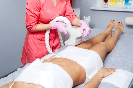 Vacuum massage thigh of a young girl. Hardware cosmetology. Spa Studio. Rejuvenation and skin tightening.