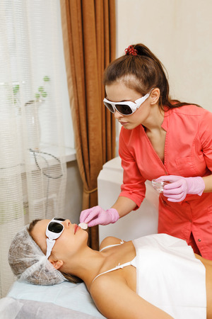 Preparation of laser hair removal on the face. Machine cosmetology. Cosmetic procedures. Spa.