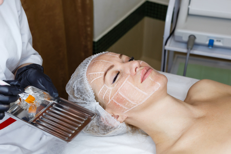 nonsurgical: Non-surgical face lifting. SMAS lifting ultrasonic. Facelift. The process of rejuvenation. Spa treatment. Hardware cosmetology. Stock Photo