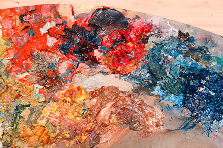 pallette: Oil paints on the wooden palette. Selection of shades. Artistic accessories. Creative tools of self-expression.