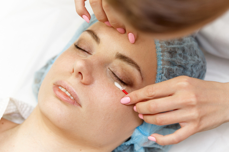 Beauty salon. Straightening eyelashes before the procedure of building. Shooting close-up. Stock Photo