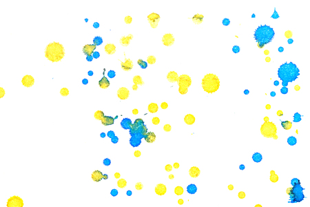 drops of water: Abstract two-color yellow blue ink splash. Ink blots. Elements of design. The water-soluble ink on white paper Leste. Abstractionism Stock Photo