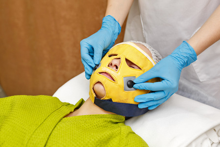 salon and spa: Hardware cosmetology. Microcurrents. Face rejuvenation with the help of microcurrent therapy.