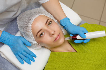 Hardware cosmetology. Mesotherapy. Dermapen. Treatment of the chin zone. Spa treatments. Face rejuvenation. Stock Photo