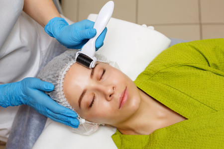 Hardware cosmetology. Mesotherapy. Dermaroller. Processing of the forehead area. Spa treatments. Face rejuvenation.