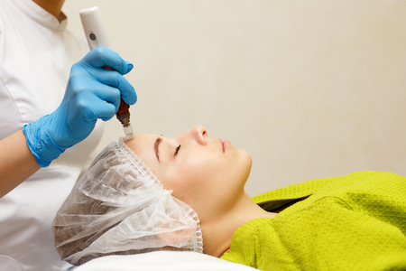 Hardware cosmetology. Mesotherapy. Dermapen. Processing of the forehead area. Spa treatments. Face rejuvenation.