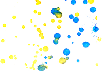 Abstract two-color yellow blue ink splash. Ink blots. Elements of design. The water-soluble ink on white paper Leste. Abstractionism Stock Photo