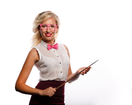 rigorous: The teacher holds a pointer. The girl is dressed in a blouse, a bow tie and glasses. Training. Positive look into the future. Back to school. Open smile.