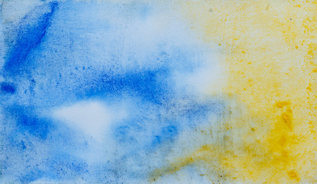 Watercolor abstraction yellow and blue background. Element of design. Color gradient. Wet watercolor technique. Textured backdrop.