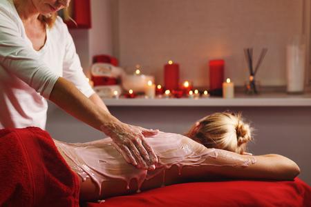 Spa treatment. Back massage with a moisturizing mask. The process of applying the mask. Deep moisturizing and rejuvenating treatments Stock Photo
