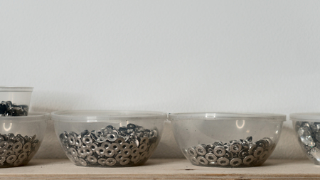 Rivet fasteners in plastic containers. Tanners workshop Фото со стока