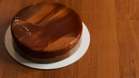 Chocolate mousse cake. The glaze freezes on the biscuits. Very tasty cake close-up.