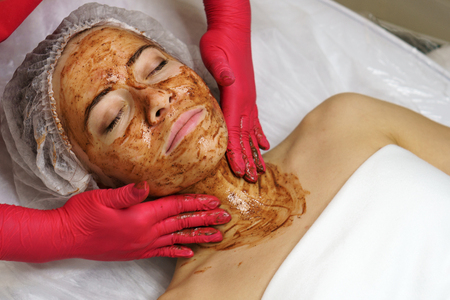 Beautician applies a moisturizing mask on the face of the girl. Spa procedure