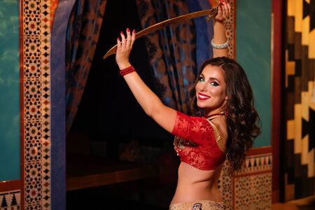 Emotional portrait gorgeous woman belly dancer dancing in traditional belly dance costume. Ethnic dance. Belly dancing. Tribal dancing.