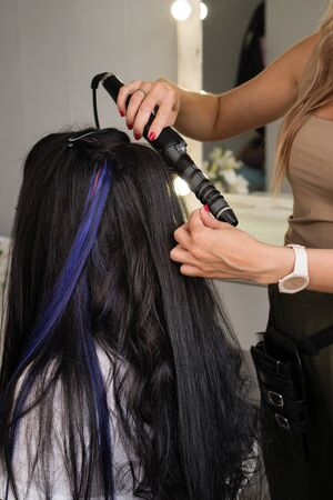 Hairdressing services. Creation of evening hairstyles fashionable stylish women's hairstyles. Hair styling process. Curls. Courses in hairdressing. Training hairdressing.  Beauty industry