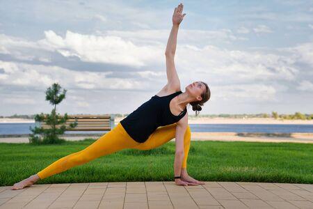 Yoga time. Beautiful woman is practicing yoga. Online marathon health and yoga. Woman yoga instructor. Foto de archivo - 129214714