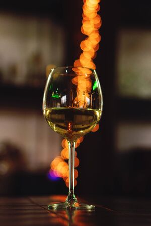 Glass with white wine, tasting, restaurant.  Concept alcoholic drinks.