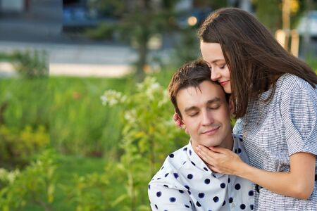 Loving man and woman having sweet tender moment together, happy millennial couple smile caressing each other, young husband and wife enjoy tenderness in summer day.
