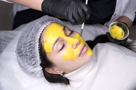 Facial brush peel retinol treatment. Woman peeling procedure. Cosmetology young girl therapy. Hyaluronic acid. Beauty concept.