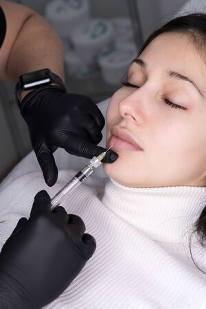 Injections of the lips. Adjustment of the lower lip form. Injection of beauty. Spa. Facial Rejuvenation. Lip augmentation.