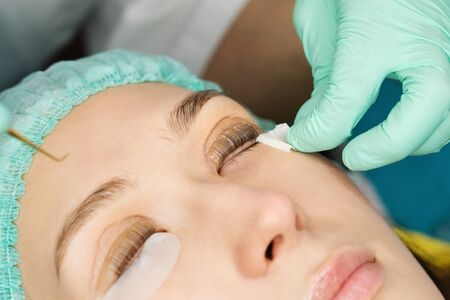Eyelash care treatment procedures. Staining, curling, laminating for lashes. Beauty model with perfect fresh skin and long eyelashes. Skincare, Spa and Wellness. Close up. Perfect layout