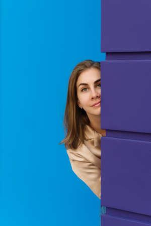 Head And Shoulders Portrait Of Emotional Girl In Blouse. Studio Shot Of Surprised Lady On Blue aAnd Violet Background.