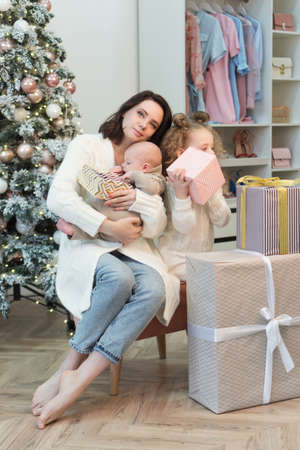 Cozy Christmas Morning Family At Home Near Chritmas Tree. Happy New Year. Concept Christmas Morning. Gifts Time Stock Photo