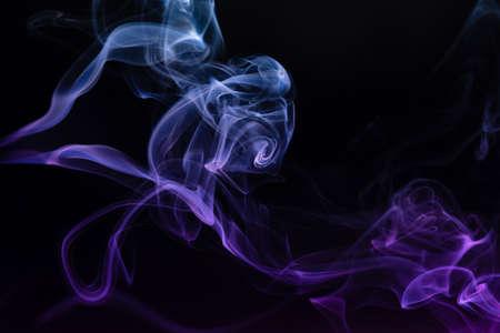 Abstract colored smoke hookah on dark background. Texture. Art Design element. Personal vaporizers fragrant steam. Concept of alternative non-nicotine smoking. E-cigarette. Evaporator. 免版税图像