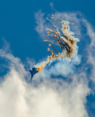 maneuver: Military aircraft fighter SU-27 nose-dive, performs the maneuver with the ejection of heat missiles