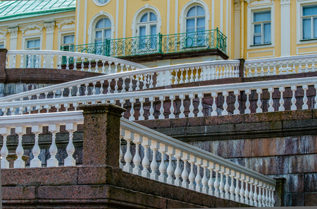 balustrades: Geometric lines with white balustrades and railings on the marble stairs of the Palace in Oranienbaum