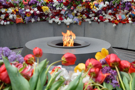 genocide: Tsitsernakaberd, The Armenian Genocide memorial complex. The eternal flame at the center of the twelve slabs. Yerevan, Armenia