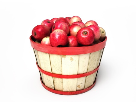 bushel: Apples sitting in a wooden basket isolated on white background