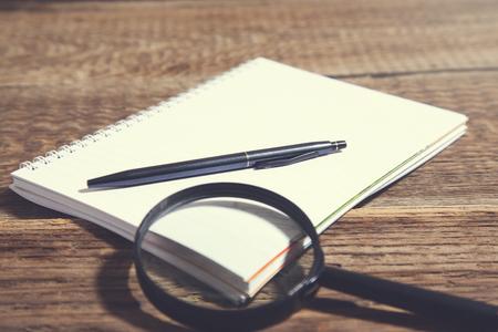 notepad on wooden desk