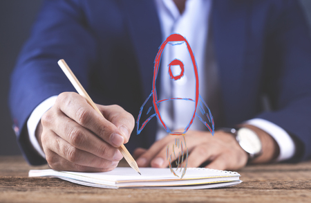 man hand pencil with notepad and racket in screen