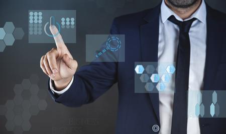 young  business man touching in virtual screen
