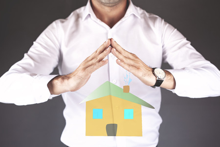 young man hand house model in screen
