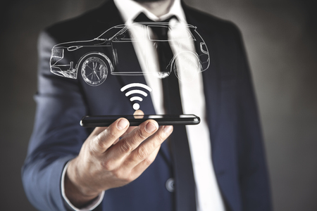 man hand phone with wifi and car in screen