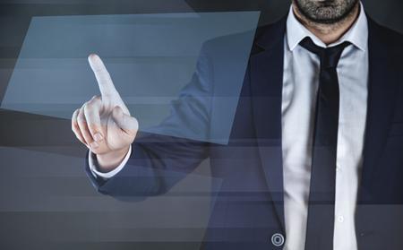 business man touching in virtual blue  screen Reklamní fotografie