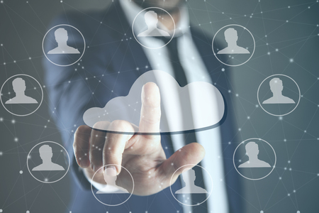 man touching in cloud and people in screen