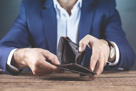 young man hand empty wallet on table