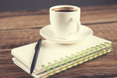 cup of coffee and pen on notepad Reklamní fotografie