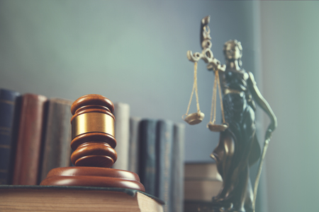 judge on book with lady justic on table