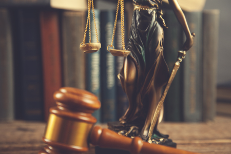 judge with  book and lady justic on table
