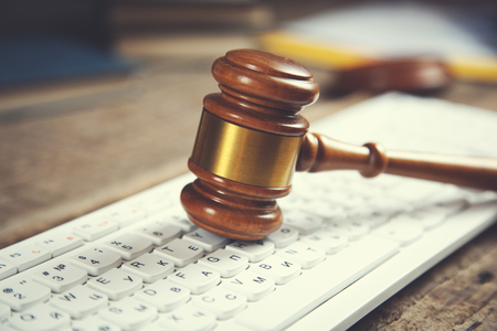 judge on computer keyboard on the table