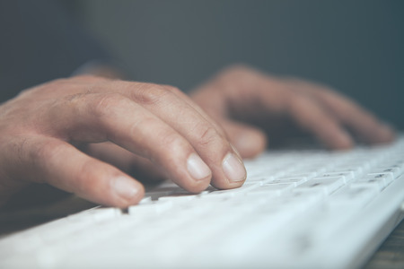 young business man hand  keyboard in desk