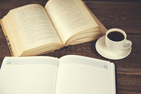 notepad with book and coffee on table Reklamní fotografie