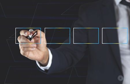 Young business man with checkbox in screen Stock Photo