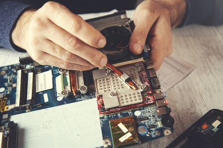 man hand tool with computer processor  on table