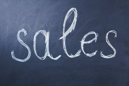 sales word on the  chalk board background